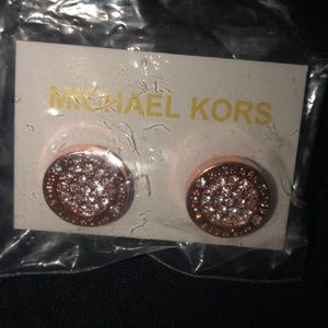 Rose gold colored earrings with crystals